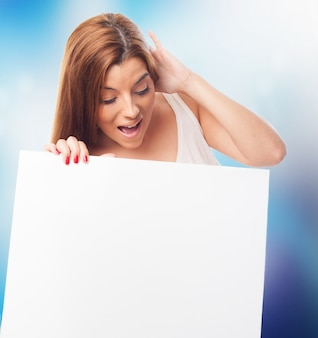 Shocked woman looking at white board.