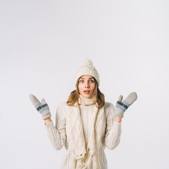 Shocked woman in warm clothes