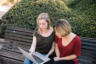 Shocked women pointing at laptop screen