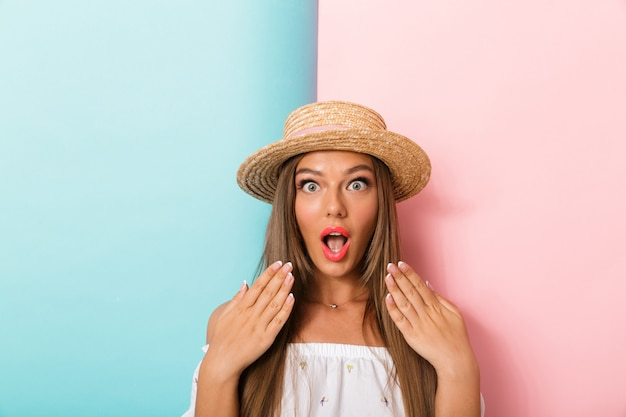 Shocked young beautiful woman posing isolated wearing hat.