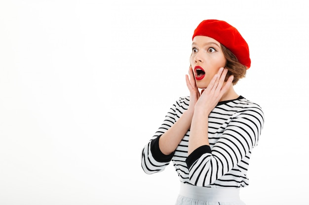 Shocked young woman isolated