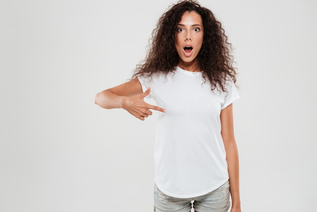 Shocked young woman with curly hair
