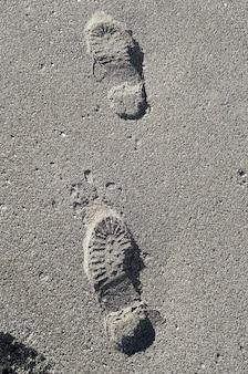 Shoe footprint imprints on a sandy beach