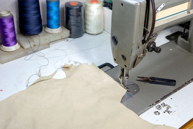 Shoe maker work place with sewing leather