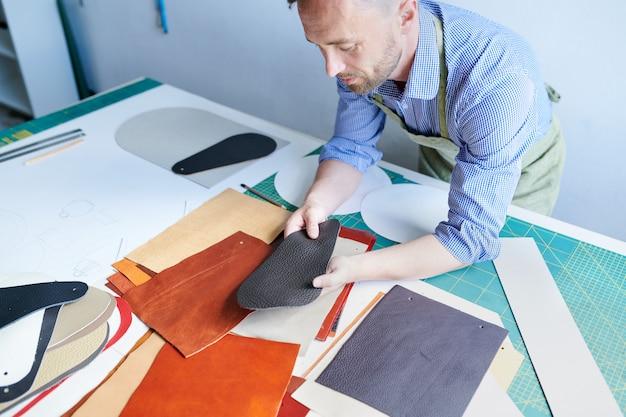 Shoemaker working at workshop