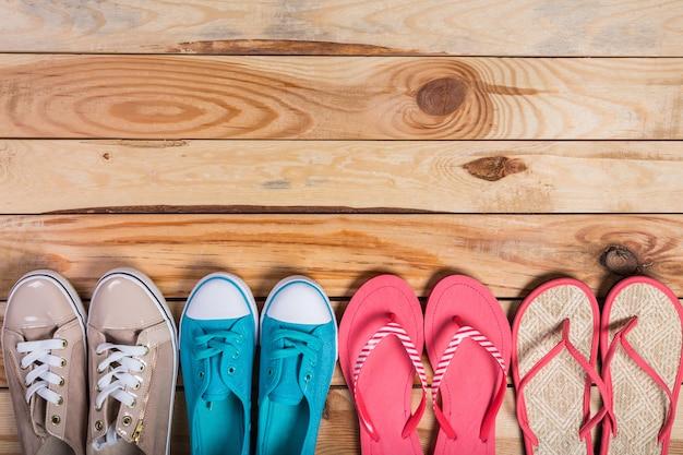 Shoes on brown wooden floor standing in line