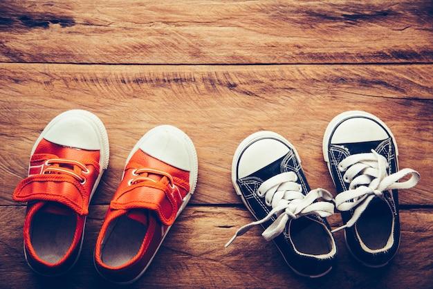 Shoes for children on wooden floor