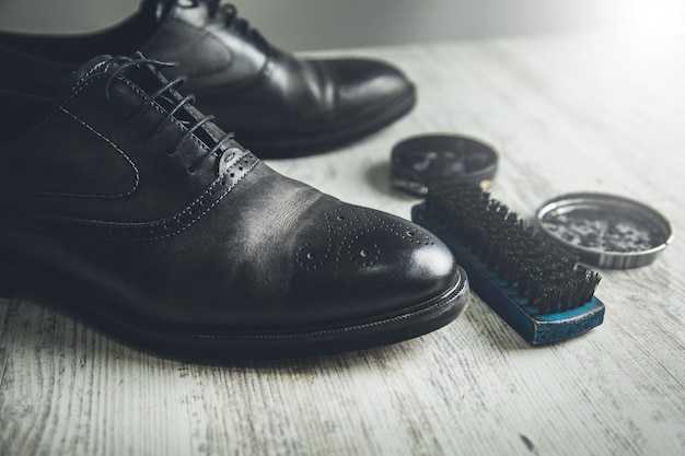 Shoes cleaning and repairing on desk