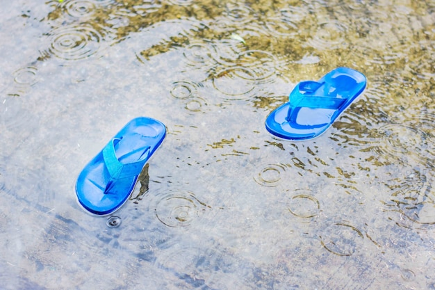 Shoes floating on flooded street and  after the rain.
