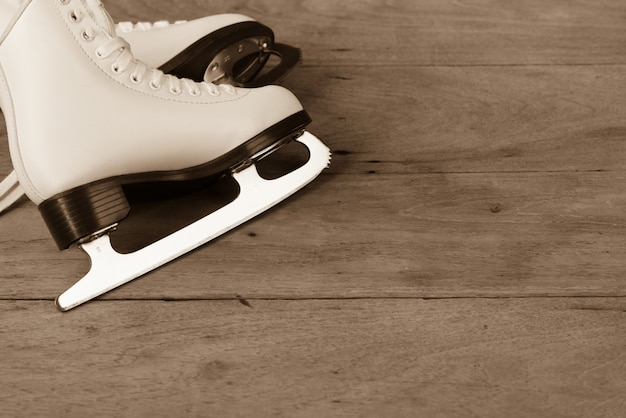 Shoes ice skating figure style of female or women on wood background