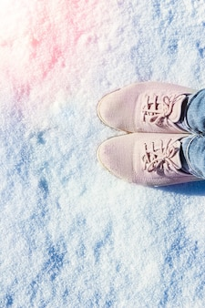 Shoes legs in the snow in winter