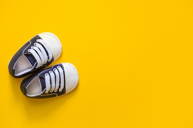 Shoes for newborns on a yellow.