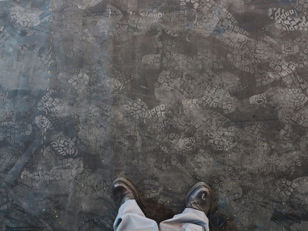 Shoes print on dark background.