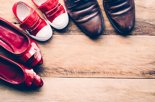 Shoes, three pairs of dad, mom, son - the family concept