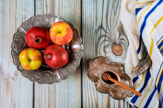 Shofar and tallit with glass honey and fresh ripe apples. jewish new year symbols. rosh hashanah