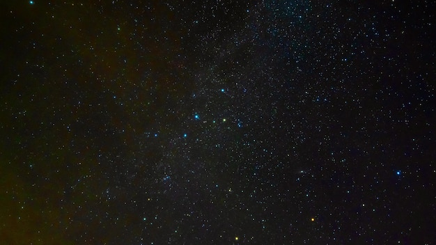 Shooting stars on the background of a starry night sky with constellations, nebulae and galaxies. timelapse of the universe and the cosmos