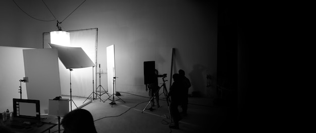 Shooting studio for photographer and creative art director with production crew team setting up