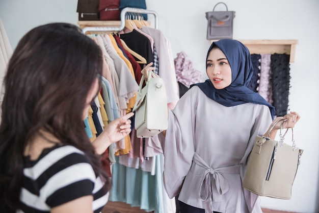 Shop assistant helps customer to choose