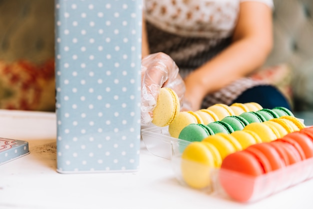 Shop assistant preparing macaron box