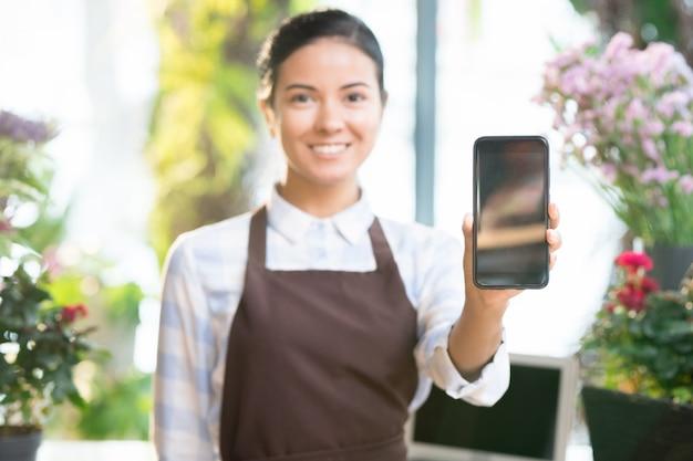 Shop assistant using smartphone