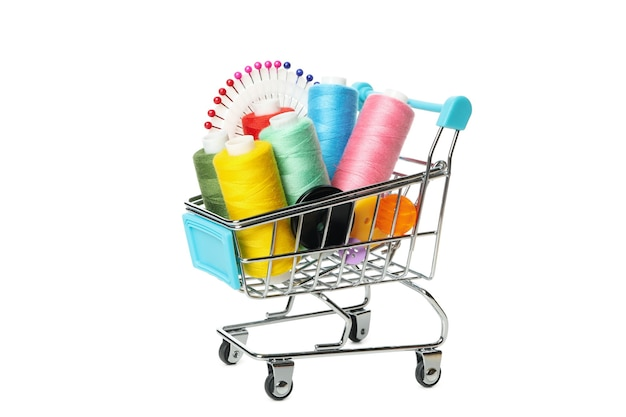Shop cart with sewing supplies isolated on white