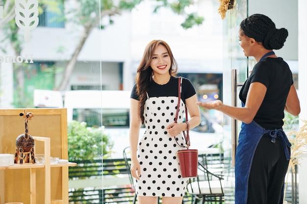 Shop owner welcoming customer