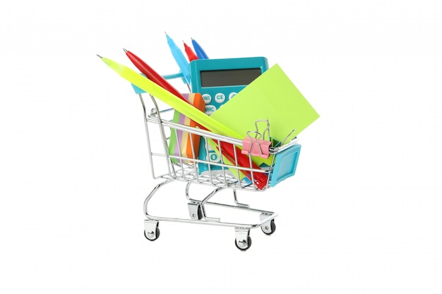 Shop trolley with stationery isolated on white