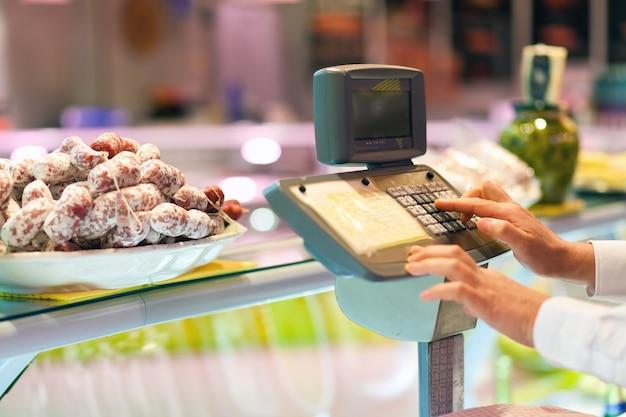 Shopkeeper cheking the food weight