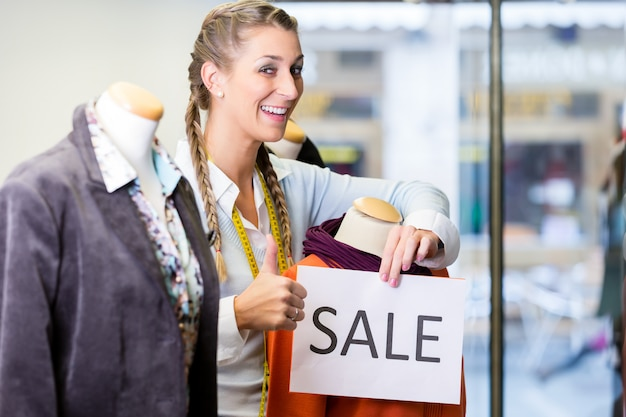 Shopkeeper working at promotion sales