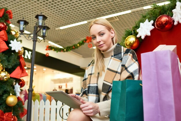 Shopper sitting with tablet pc