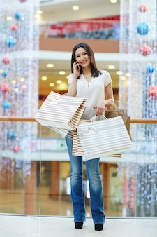 Shopper with bags and phone