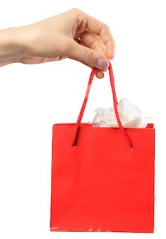 Shopping bag. female hand holding shopping bag on white