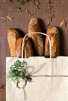 Shopping bag with bread on the wooden, online delivery concept.