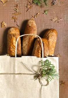 Shopping bag with bread on the wooden