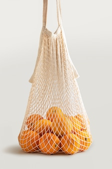 Shopping bag with fresh seasonal oranges