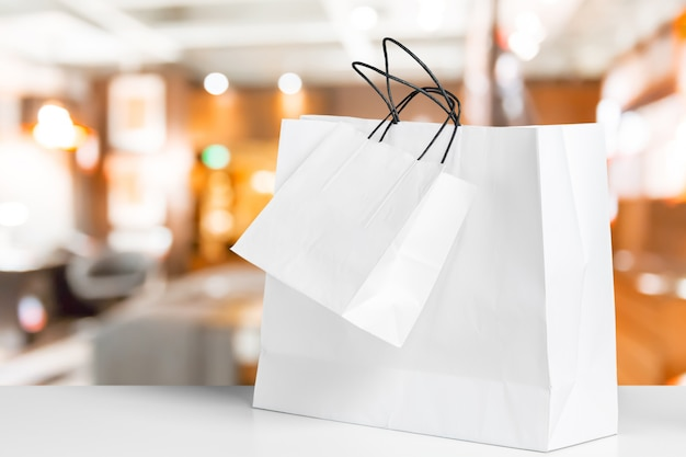 Shopping bag on wooden table