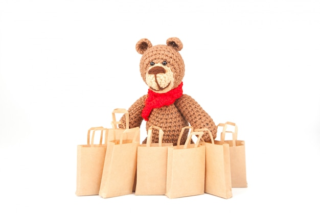 Shopping bags. sales trade, discounts. use of eco-friendly materials. zero waste. white , isolate. knitted teddy bear, amigurumi, handmade