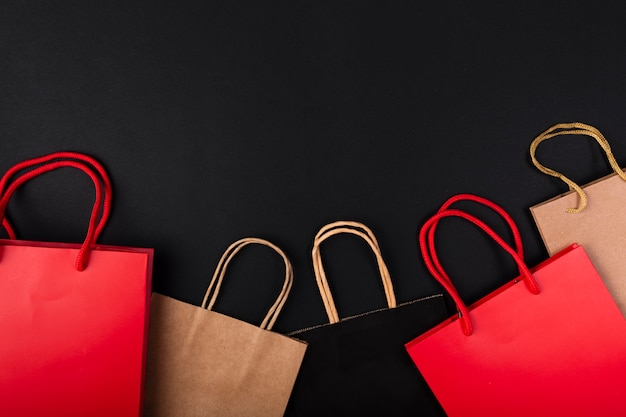 Shopping bags in various colors with copy-space