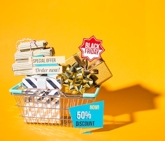 Shopping basket with present box and papers