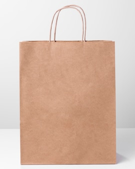 Shopping brown paper bag with thin handles front view