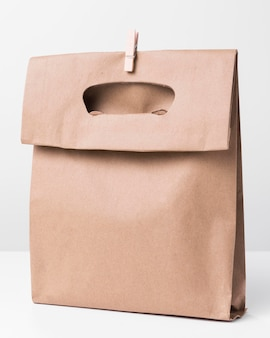Shopping brown paper bag with wooden clip
