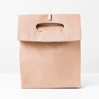 Shopping brown paper bag and wooden clip front view