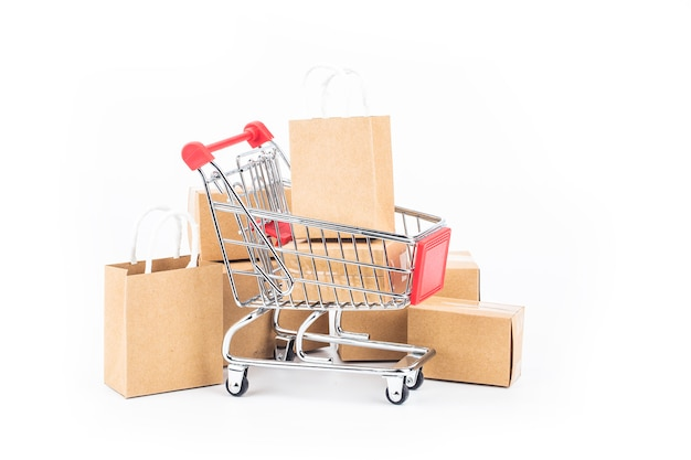 Shopping cart, bags and boxes isolated