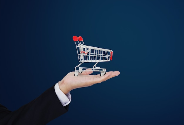 Shopping cart on businessman's hand