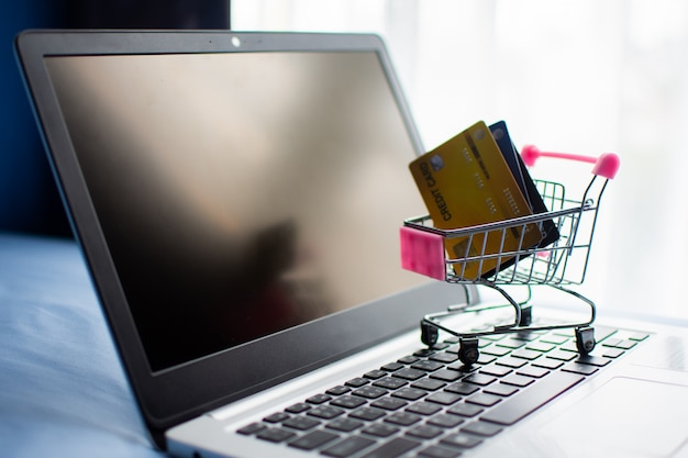Shopping cart and credit card on computer, shopping online concept.