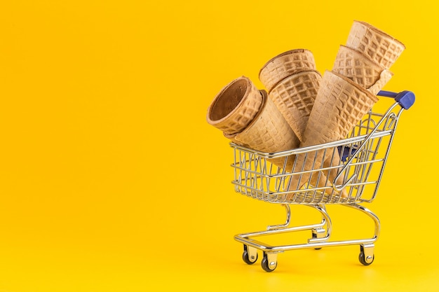 Shopping cart filled with empty ice cream cones