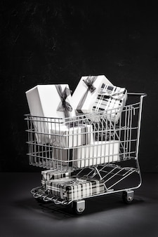 Shopping cart full of gift boxes. sopping on black friday concept.