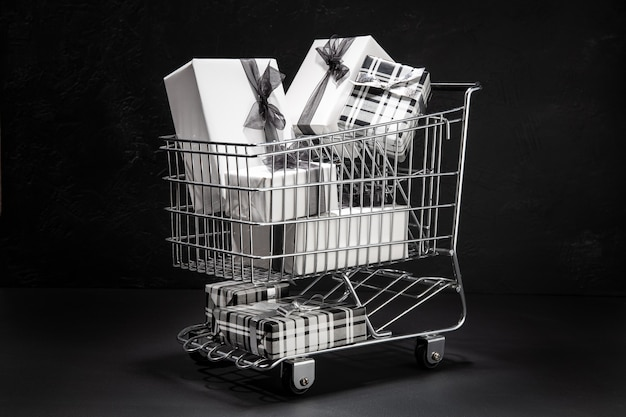 Shopping cart full of gift boxes. sopping on black friday concept