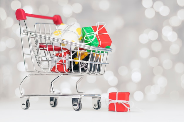 The shopping cart is filled with different gifts for the holiday