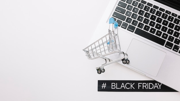 Shopping cart and laptop with copy space